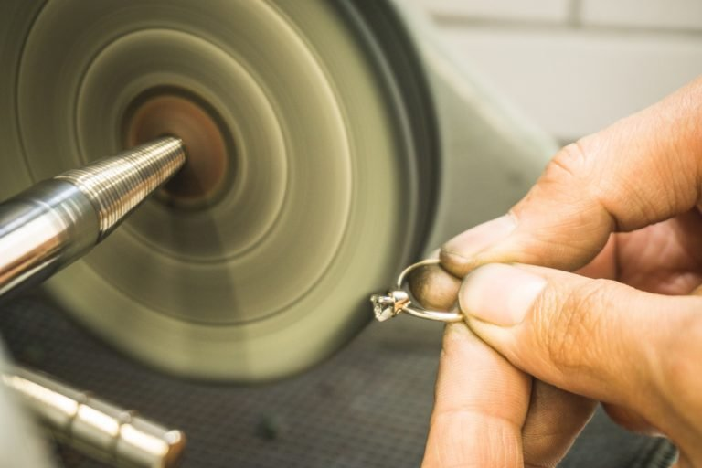 Maintenance of precious diamond ring in jewellery workshop