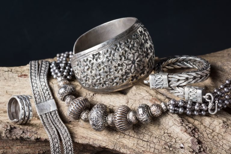 traditional silver jewelry on old wood